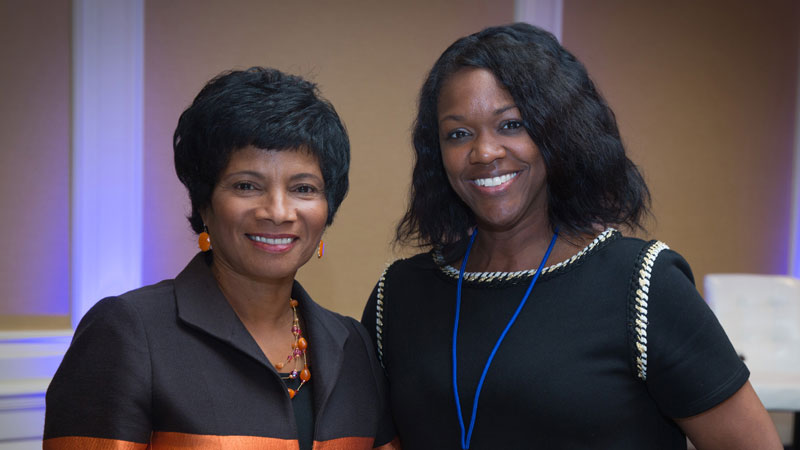Two black women smiling